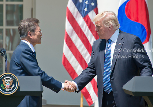 United States President Donald J. Trump and President Moon Jae-in of the Republic of Korea shake hands as they make joint statements in the Rose Garden of the White House in Washington, DC on Friday, June 30, 2017.  <br /> Credit: Ron Sachs / CNP