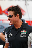 Aug 19, 2016; Brainerd, MN, USA; Papa Johns pizza founder John Schnatter in the pit area of NHRA top fuel driver Leah Pritchett during qualifying for the Lucas Oil Nationals at Brainerd International Raceway. Mandatory Credit: Mark J. Rebilas-USA TODAY Sports