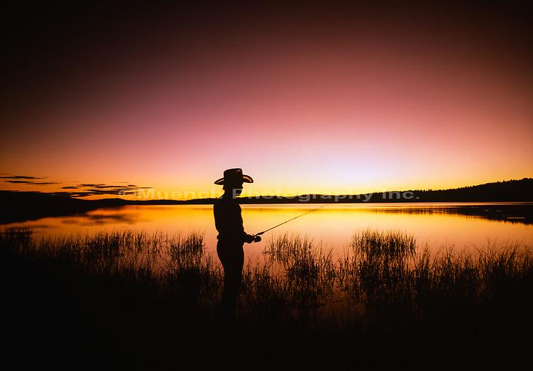 Person fishing at dawn,Big Lake,White Mountains,Arizona