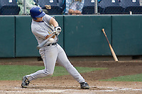 August 7, 2007: Tri-City Dust Devils' infielder Darin Holcomb connects with a belt-high offering against the Everett AquaSox in a Northwest League game at Everett Memorial Stadium in Everett, Washington.