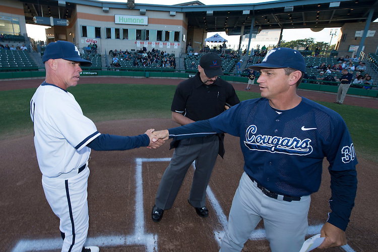 May 23, 2013; Stockton, CA, USA; San Diego Toreros head coach Rich Hill (left) shakes hands with BYU Cougars head coach Mike Littlewood (right) during the WCC Baseball Championship at Banner Island Ballpark.