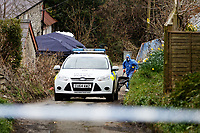 "Pictured: Forensics officers using a wheel barrow, empty contents to a recycling skip at the house in Aberaeron, where the remains of a woman have been discovered in Ceredigion County, Wales, UK. Wednesday 21 March 2018<br /> Re: Human remains have been found in a house following a police investigation to find a missing woman.<br /> Police were called to the property in Aberaeron, west Wales after a woman in her 50s collapsed.<br /> Police also discovered the woman's mother, in her 80s, who had not been seen for some time.<br /> The women were named locally as Gaynor and Valerie Jones, with police currently treating the death as unexplained.<br /> The two women have ben described as ""reclusive"" by neighbours and the home they shared as being ""heavily cluttered""."