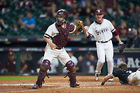 Mississippi State Bulldogs relief pitcher Blake Smith (42) makes an out sign with his fist after catcher Dustin Skelton (8) tagged out Nick Slaughter (38) of the Houston Cougars as he tried to steal home in game six of the 2018 Shriners Hospitals for Children College Classic at Minute Maid Park on March 3, 2018 in Houston, Texas. The Bulldogs defeated the Cougars 3-2 in 12 innings. (Brian Westerholt/Four Seam Images)