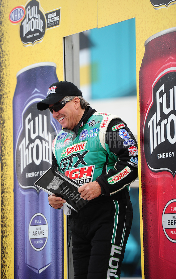 Sept. 16, 2011; Concord, NC, USA: NHRA funny car driver John Force during qualifying for the O'Reilly Auto Parts Nationals at zMax Dragway. Mandatory Credit: Mark J. Rebilas-US PRESSWIRE