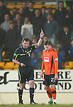 St Johnstone v Dundee United....22.02.11 .David Goodwilie is booked by ref John McKendrick in front of the saints fans who gave him abuse throughout the game.Picture by Graeme Hart..Copyright Perthshire Picture Agency.Tel: 01738 623350  Mobile: 07990 594431