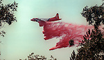 August 11, 1990 Yosemite National Park  --  A-Rock (Arch Rock) Fire  -- Air tanker drops a load of retardant on the fire line at Moss Creek.  The Arch Rock Fire burned over 16,000 acres of Yosemite National Park and the Stanislaus National Forest.  At the same time across the Merced River, the Steamboat Fire burned over 5,000 acres of both Yosemite National Park and the Sierra National Forest.
