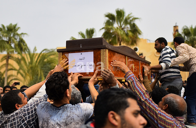 Mourners carry the coffin of one of the victims of the blast at the Coptic Christian Saint Mark's church in Alexandria the previous day during a funeral procession at the Monastery of Marmina in the city of Borg El-Arab, east of Alexandria on April 10, 2017. Egypt prepared to impose a state of emergency after jihadist bombings killed dozens at two churches in the deadliest attacks in recent memory on the country's Coptic Christian minority. Photo by Amr Sayed