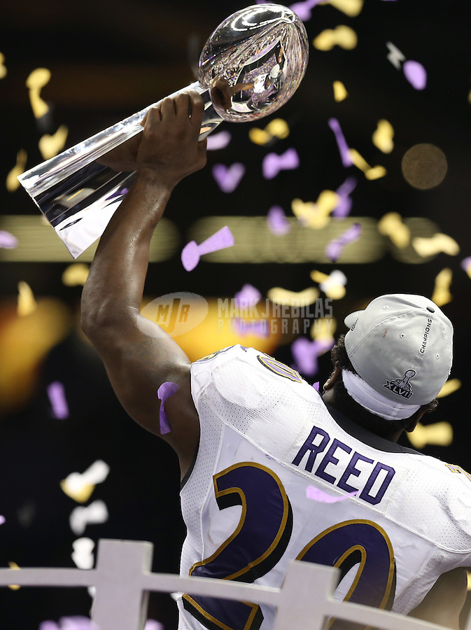 Feb 3, 2013; New Orleans, LA, USA; Baltimore Ravens free safety Ed Reed kisses the Vince Lombardi Trophy after defeating the San Francisco 49ers in Super Bowl XLVII at the Mercedes-Benz Superdome. Mandatory Credit: Mark J. Rebilas-