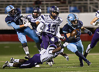 Arkansas Democrat-Gazette/MELISSA SUE GERRITS - 12/05/15 -  Fayetteville's Mason Shaw gets a hand on Har-Ber's Blaze Brothers before he is taken down in the 3rd quarter during their 7A Championship game December 5, 2015 at War Memorial Stadium in Little Rock.