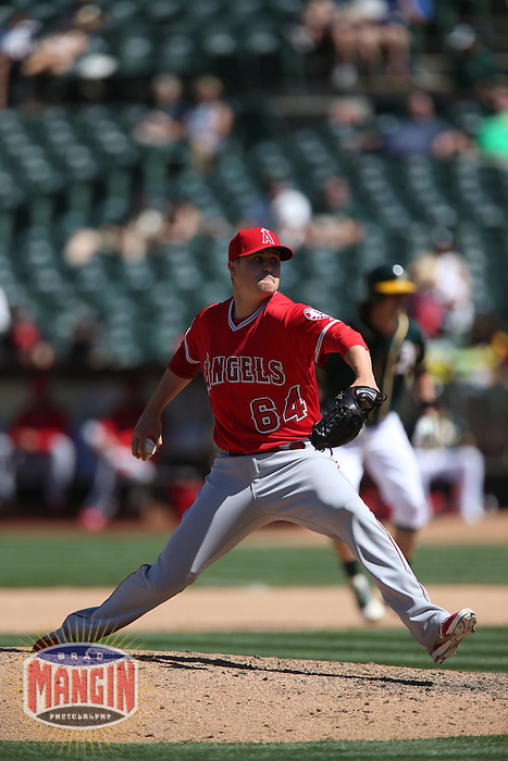 OAKLAND, CA - APRIL 30:  Mike Morin #64 of the Los Angeles Angels pitches against the Oakland Athletics during the game at O.co Coliseum on Thursday, April 30, 2015 in Oakland, California. Photo by Brad Mangin