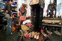 Customers browse at Glanz & Gloria vintage clothing store, Brunngasse, Bern, Switzerland, 27 August 2011
