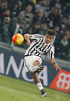 Juventus' Paulo Dybala kicks the ball during the Italian Serie A football match between Juventus and Roma at Juventus Stadium.