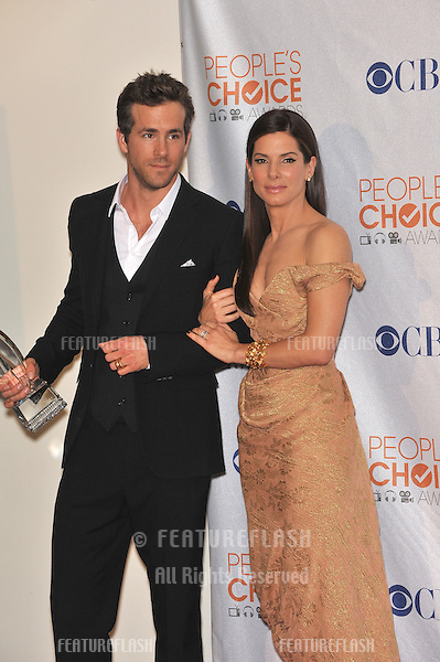 Sandra Bullock & Ryan Reynolds at the 2010 People's Choice Awards at the Nokia Theatre L.A. Live in Los Angeles..January 6, 2010  Los Angeles, CA.Picture: Paul Smith / Featureflash