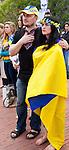 Julia Kosivchuk, of San Francisco, and an unidentified friend, sing the Ukrainian anthem at the Ukrainian rally in Justin Herman Plaza, in San Francisco, California, on Sunday, March 9th, 2014.  Photo/Victoria Sheridan