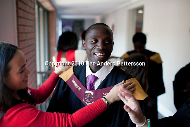 JOHANNESBURG, SOUTH AFRICA - JUNE 5: Joseph Munyambanza, a student from the Democratic Republic of Congo gets dressed before the African Leadership Academy (ALA) graduation day ceremony in the school in Honeydew, west of Johannesburg, South Africa. ALA is a secondary school and about 3000 students apply every year. The most promising students are taken in and they get an outstanding education. Many are from poor backgrounds and receive financial help to study. The school's mission is to have the students work in Africa, to bring a change in Africa, and not get tempted to work in the US or Europe, where the financial opportunities are better. (Photo by Per-Anders Pettersson/Getty Images)