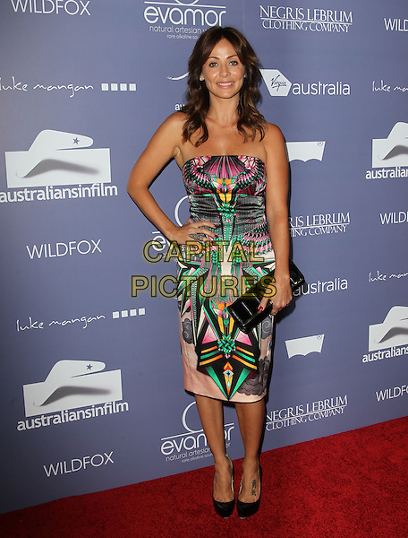 Natalie Imbruglia.Australians in Film 8th Annual Breakthrough Awards held at The Hotel Intercontinental in Century City, California, USA..June 27th, 2012.full length strapless pink black green print dress hand on hip black clutch bag shoes .CAP/ADM/KB.©Kevan Brooks/AdMedia/Capital Pictures.