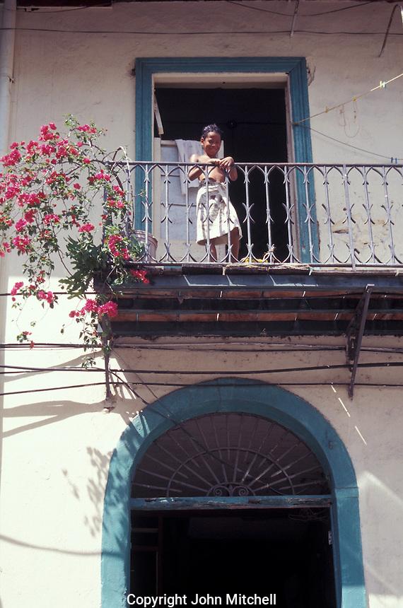 Child on the balcony of an old house in Casco Viejo, Panama City, Panama