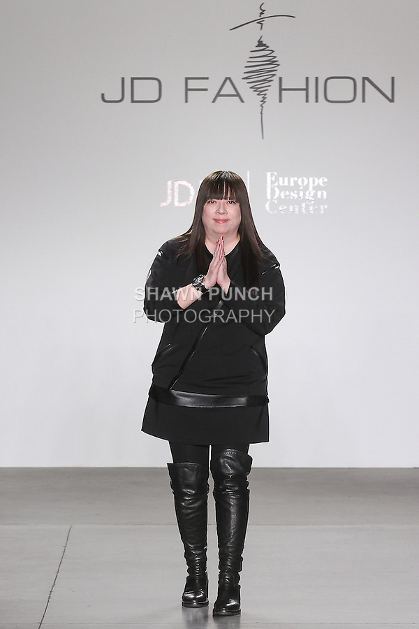 Fashion designer Gioia Pan thanks audience for attending her Gioia Pan Fall 2016 collection, for the JD Fashion Fall 2016 runway show at Pier 59 Studios for NYFW: The Shows, during New York Fashion Week Fall 2016.