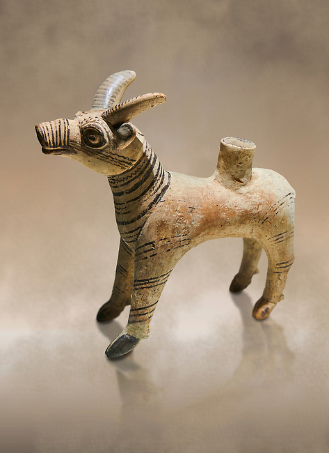 Bronze Age Anatolian terra cotta antilope shaped ritual vessel- 19th to 17th century BC - Kültepe Kanesh - Museum of Anatolian Civilisations, Ankara, Turkey.  Against a warn art background.