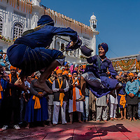 ANANDPUR SAHIB, INDIA - March 06, 2015: Young Nihangs, or &quot;Sikh warriors&quot;  perform Gatka (mock encounters with real weapons) during Hola Mohalla celebrations on March 06, 2015 in Anandpur Sahib, India. Hola Mahalla or simply Hola is a Sikh event, which takes place on the first of the lunar month of Chet, which usually falls in March, and sometimes coincides with the Sikh New Year. It was started by Guru Gobind Singh the tenth Sikh guru in 1701 AD. Hola Mohalla is a three day Sikh festival, in which Nihang Sikh 'warriors' perform Gatka (mock encounters with real weapons), tent pegging and bareback horse-riding.<br /> Daniel Berehulak for The New York Times