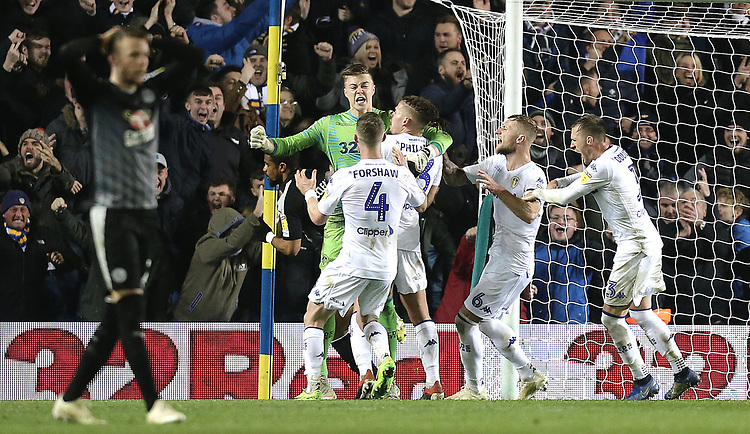 Leeds United's Bailey Peacock-Farrell roars in celebration and is mobbed by team-mates after saving a late penalty effort by Reading's Marc McNulty<br /> <br /> Photographer Rich Linley/CameraSport<br /> <br /> The EFL Sky Bet Championship - Leeds United v Reading - Tuesday 27th November 2018 - Elland Road - Leeds<br /> <br /> World Copyright © 2018 CameraSport. All rights reserved. 43 Linden Ave. Countesthorpe. Leicester. England. LE8 5PG - Tel: +44 (0) 116 277 4147 - admin@camerasport.com - www.camerasport.com