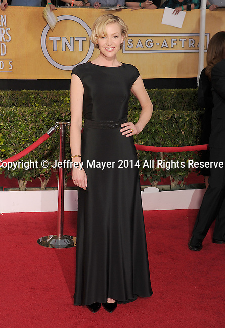 LOS ANGELES, CA- JANUARY 18: Actress Portia De Rossi arrives at the 20th Annual Screen Actors Guild Awards at The Shrine Auditorium on January 18, 2014 in Los Angeles, California.