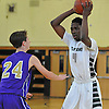 KC Ndefo #4 of Elmont, right, looks to pass around Kris Kopyc #24 of Christian Brothers Academy (Albany) during a non-league varsity boys basketball game in the Upstate-Downstate Challenge at Uniondale High School on Saturday, Dec. 3, 2016. Ndefo scored 28 points in Elmont's 57-46 win.
