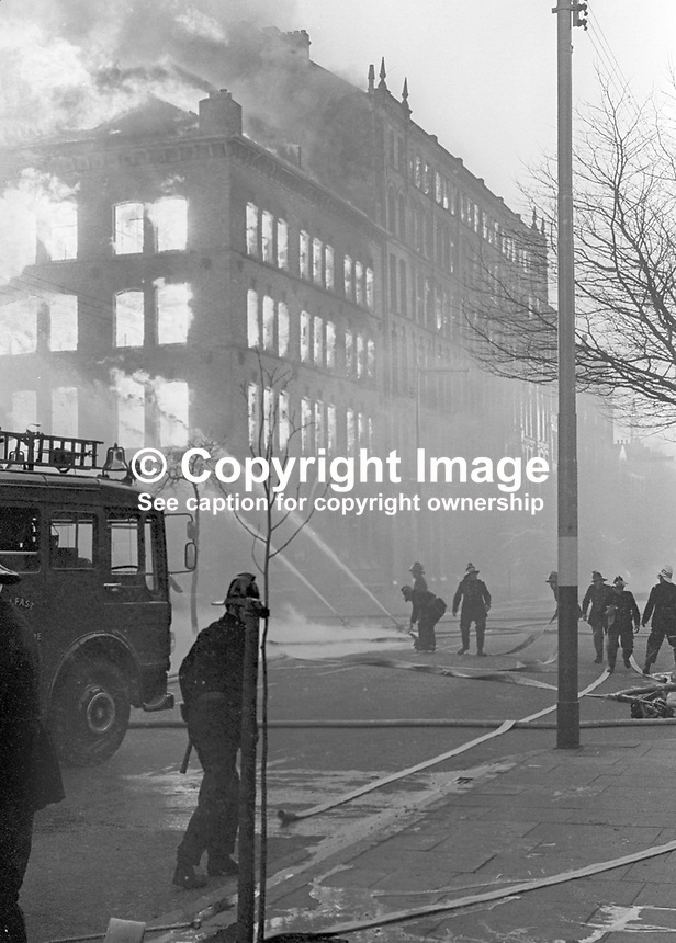 Firemen tackle blaze in Dublin Road, Belfast, N Ireland, following Provisional IRA explosions 6th December 1971. 197112060541b<br />