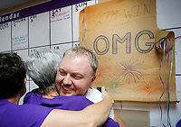 NWA Democrat-Gazette/DAVID GOTTSCHALK  Shannon Hix, campaign manager, receives hugs Tuesday, September 8, 2015 from supporters after the announcement of the passing of the Uniform Civil Rights Administration ordinance at the campaign headquarters for For Fayetteville.