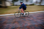 A bicyclist rushes down the hill at the end of Parkview Avenue in Westerville, Ohio. From the Walking Westerville Series. Photo Copyright Gary Gardiner. Not be used without written permission detailing exact usage.