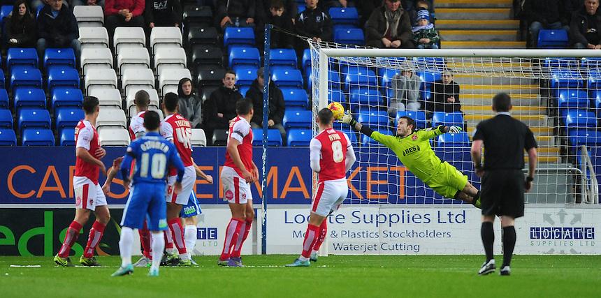 Fleetwood Town's Chris Maxwell makes a one-handed save from a free kick taken by Peterborough United's Jon Taylor<br /> <br /> Photographer Chris Vaughan/CameraSport<br /> <br /> Football - The Football League Sky Bet League One - Peterborough United v Fleetwood Town - Saturday 14th November 2015 - ABAX Stadium - Peterborough<br /> <br /> &copy; CameraSport - 43 Linden Ave. Countesthorpe. Leicester. England. LE8 5PG - Tel: +44 (0) 116 277 4147 - admin@camerasport.com - www.camerasport.com