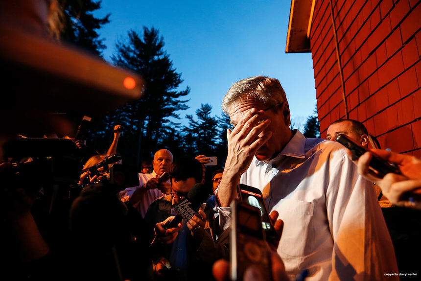 """Concord, NH,  Thursday, April 16, 2015:  GOP White House prospect former Gov. Jeb Bush adjusts his glasses before talking to the media after speaking at a """"Politics and Pie"""" event at the Snow Shoe Club.  CREDIT: Cheryl Senter for The Boston Globe"""
