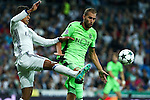Real Madrid's Raphael Varane and Sporting Clube de Portugal's Andre Felipe De Souza during the match of Champions League group 6 round 1, between Real Madrid an Sporting Clube de Portugal at Santiago Bernabeu Stadium in Madrid September 14, 2016. (ALTERPHOTOS/Rodrigo Jimenez)