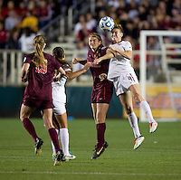 Kassey Kallman () of Florida State goes up for a header with Murielle Tiernan (20) of Virginia Tech during the Women's College Cup semifinals at WakeMed Soccer Park in Cary, NC. Florida State defeated Virginia Tech, 3-2.
