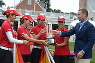 Owings Mills, MD - July 27, 2014: Team Spain accepts the International Crown trophy from LPGA Commissioner Michael Whan after winning the inaugural tournament held at the Caves Valley Golf Club in Owings Mills, MD on July 27, 2014. 32 players from twelve countries competed in this inaugural tournament.  (Photo by Don Baxter/Media Images International)