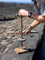 Ancient Hawaiian drill made of wood and lava rock