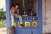 Redencao, Brazil. Wooden booth to buy gold; scales, portable television, car radio. Para State.
