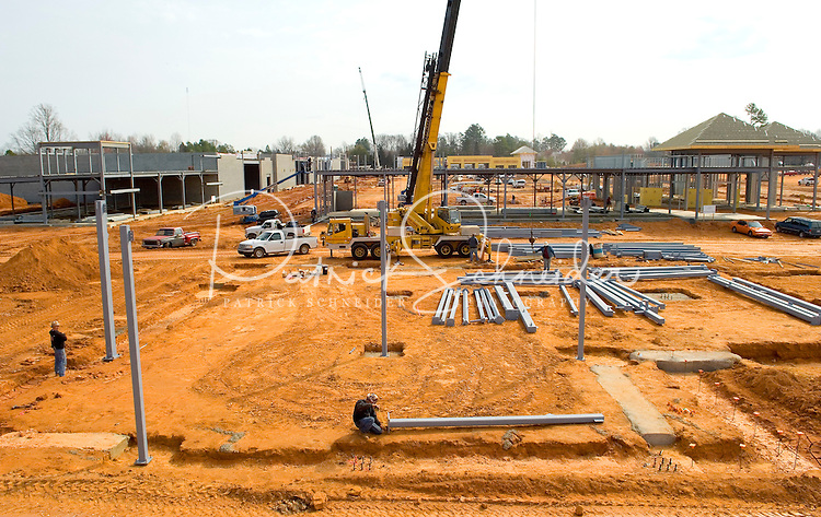 02/22/07:  A new shopping center rises from the red Carolina clay dirt during an expansion project.  Charlotte, NC, is one of the country's fastest-growing cities. ..By Patrick Schneider- Patrick Schneider Photography.