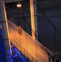 Men talking on the bridge over the Osum river at night time, in Berat, South-Central Albania, capital of the District of Berat and the County of Berat. In July 2008, the old town (Mangalem district) was listed as a UNESCO World Heritage Site. Picture by Manuel Cohen