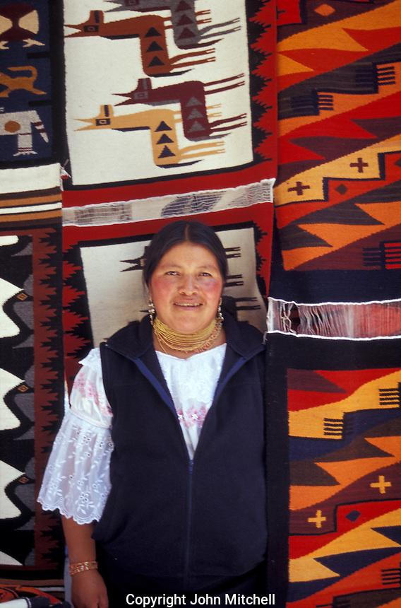 Indigenous rug vendor at the Handicrafts market in Poncho Plaza, Otavalo, Ecuador