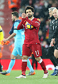 17th March 2018, Anfield, Liverpool, England; EPL Premier League football, Liverpool versus Watford; Mohammed Salah of Liverpool applauds the support from the Kop as he leaves the pitch with the match ball