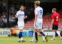 Leeds United's Jack Harrison celebrates scoring his side's fourth goal, his second, with Patrick Bamford<br /> <br /> Photographer Alex Dodd/CameraSport<br /> <br /> Football Pre-Season Friendly - York City v Leeds United - Wednesday 10th July 2019 - Bootham Crescent - York<br /> <br /> World Copyright © 2019 CameraSport. All rights reserved. 43 Linden Ave. Countesthorpe. Leicester. England. LE8 5PG - Tel: +44 (0) 116 277 4147 - admin@camerasport.com - www.camerasport.com