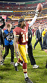 Washington Redskins quarterback Robert Griffin III is acknowledges the cheers of the fans as he leaves the field following his team's 17 - 16 victory over the New York Giants at FedEx Field in Landover, Maryland on Monday, December 3, 2012.  .Credit: Ron Sachs / CNP