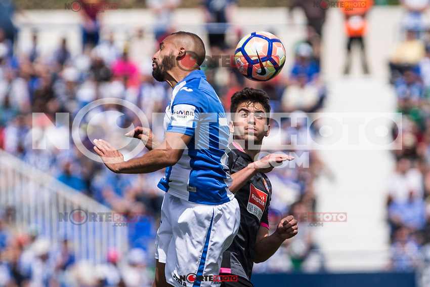 Siovas of Club Deportivo Leganes competes for the ball with Diego Reyes of RCD Espanyol during the match of La Liga between  Club Deportivo Leganes and RCD Espanyol at Butarque  Stadium  in Leganes, Spain. April 16, 2017. (ALTERPHOTOS / Rodrigo Jimenez)