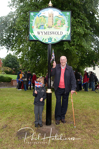 Olympic Torch passes through Wymeswold on 3rd July 2012, followed by the unvailing of the new Village Sign, desogned by Susan Crinage