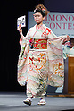 February 18, 2012, Tokyo, Japan - A contestant shows off her kimono on stage during the 2012 Kimono Queen Contest. Approximately 500 women dressed in beautifully designed kimonos participate in this annual event for a chance to win special prizes and given the opportunity to be recognized as a kimono model in various media outlets. (Photo by Christopher Jue/AFLO)