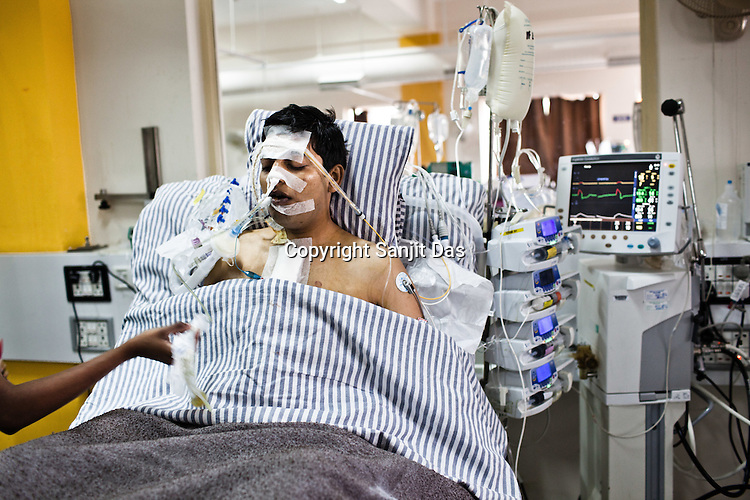 A nurses speaks to Ajay Singh Goyal (23) at the Intensive Care Unit of the Narayana Hrudayalaya in Bangalore, Karnataka, India. Dr. Shetty had conducted an open heart surgery on the same patient a day before. Photo: Sanjit Das/Panos