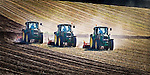 Three tractors work in unison as they cultivate oat stubble in readiness for future plantings..This New Zealand Fine Art Landscape Print, available in four sizes on either archival Hahnemuhle Fine Art Pearl paper or canvas, is printed using Epson K3 Ultrachrome inks and comes with a lifetime guarantee against fading..All prints are signed and numbered on the lower margin and come with my 100% money back guarantee on the purchase price, should you not be  completely happy with the quality of the delivered print or canvas.
