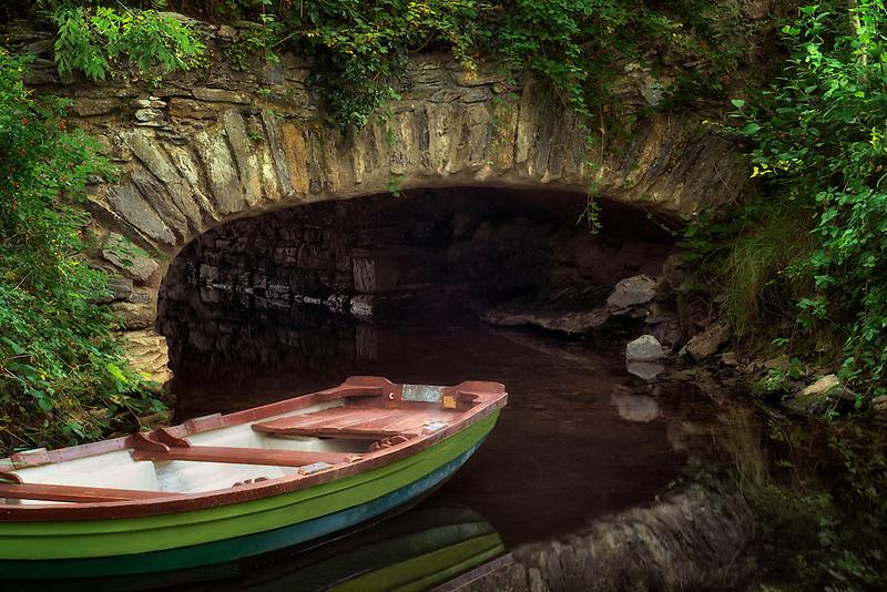 Boat near bridge. Killarney National Park, Ireland