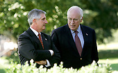 Washington, D.C. - September 3, 2005 -- White House Chief of Staff Andrew Card and Vice President Dick Cheney talk and watch United States President George W. Bush deliver his weekly radio address. The event was held in the Rose Garden of the White House on September 3, 2005. <br /> Credit: Dennis Brack - Pool via CNP